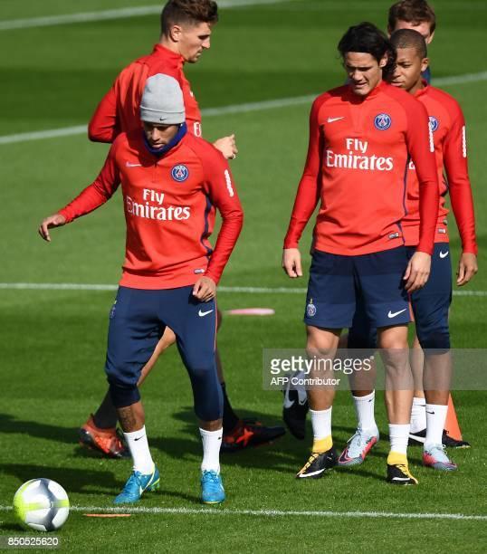Paris SaintGermain's Brazilian forward Neymar and Paris SaintGermain's Uruguayan forward Edinson Cavani and Paris SaintGermain's French forward...
