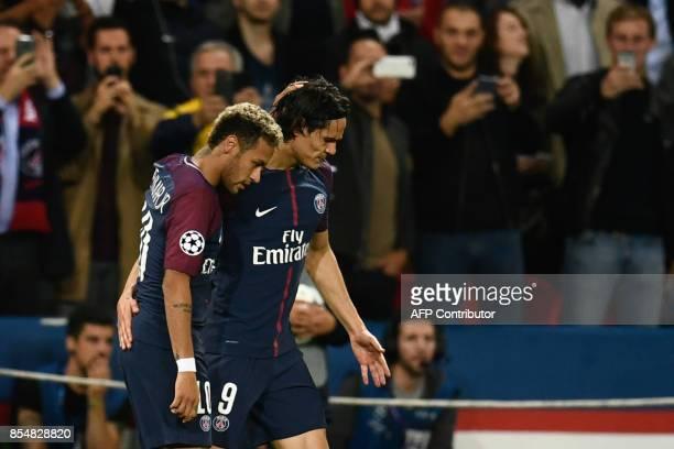 Paris SaintGermain's Brazilian forward Neymar and Paris SaintGermain's Uruguayan forward Edinson Cavani react during the UEFA Champions League...
