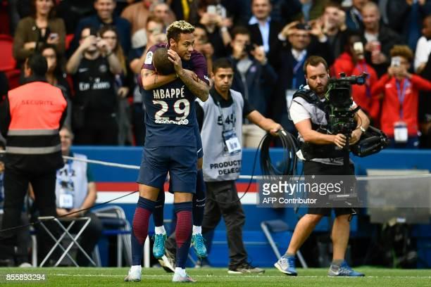 Paris SaintGermain's Brazilian forward Neymar and Paris SaintGermain's French forward Kylian Mbappe celebrate after Neymar opened the scoring during...