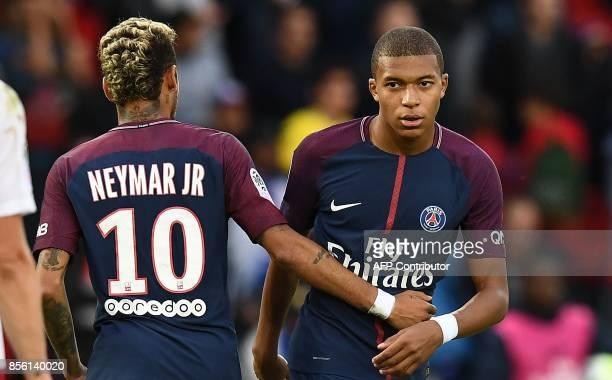 Paris SaintGermain's Brazilian forward Neymar and Paris SaintGermain's French forward Kylian Mbappe react during the French Ligue 1 football match...