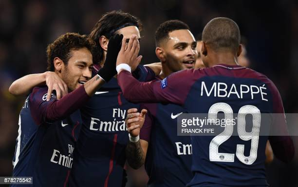Paris SaintGermain's Brazilian forward Neymar and Paris SaintGermain's French forward Kylian MBappe react after a goal of Paris SaintGermain's...