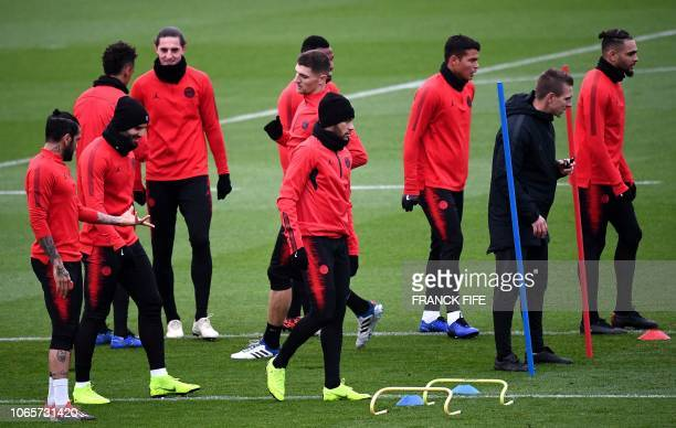 Paris SaintGermain's Brazilian forward Neymar and teammates attend a training session in SaintGermainenLaye west of Paris on November 27 on the eve...