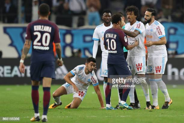 Paris SaintGermain's Brazilian forward Neymar argues with Marseille's Brazilian midfielder Luiz Gustavo during the French L1 football match between...