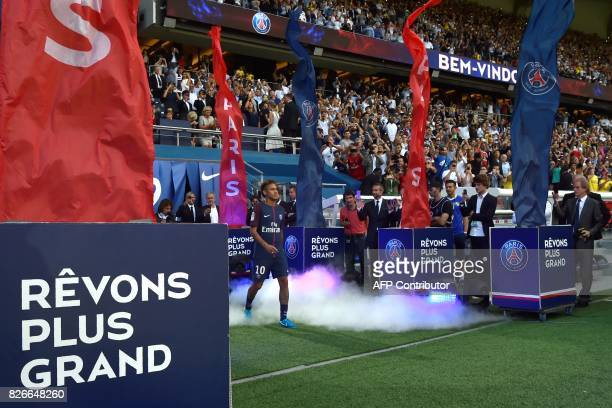 TOPSHOT Paris SaintGermain's Brazilian forward Neymar arrives on the football field during his presentation to the fans at the Parc des Princes...