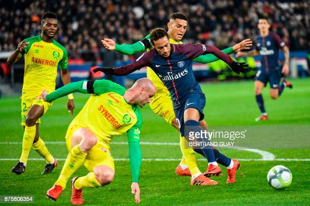 Paris SaintGermain's Brazilian forward Neymar attempts to dribble Nantes' Nigerian defender Chidozie Awaziem Nantes' French defender Nicolas Pallois...