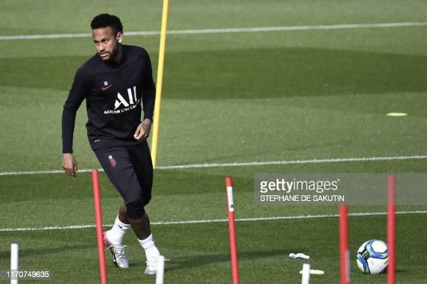 Paris SaintGermain's Brazilian forward Neymar attends a training session at the club's Camp des Loges training grounds in SaintGermainenLaye west of...