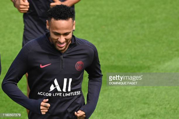 TOPSHOT Paris SaintGermain's Brazilian forward Neymar attends a training session of French L1 football club Paris SaintGermain in SaintGermainenLaye...