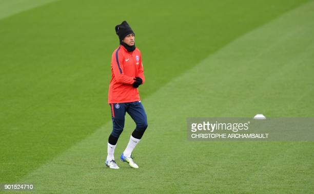 Paris SaintGermain's Brazilian forward Neymar attends a training session of French L1 football club Paris SaintGermain in SaintGermainenLaye west of...