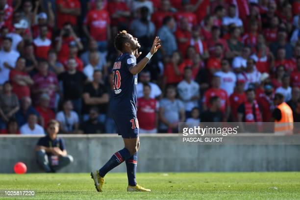 Paris SaintGermain's Brazilian forward Neymar celebrates after scoring the opener during the French L1 football match between Nimes and Paris...