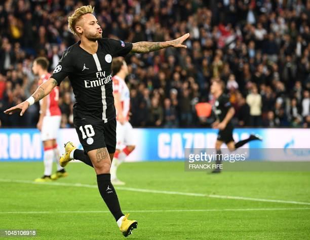 Paris SaintGermain's Brazilian forward Neymar celebrates after scoring a second goal during the UEFA Champions' League football match Paris Saint...