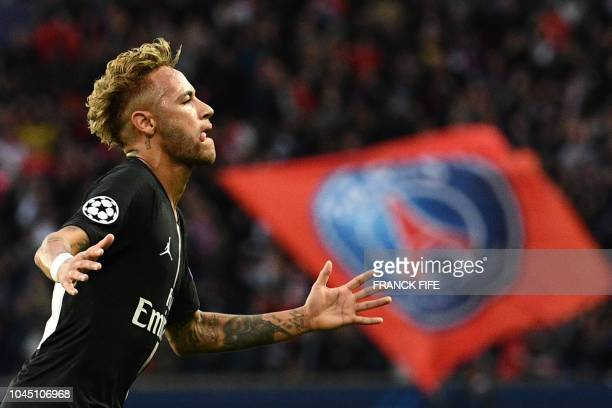 TOPSHOT Paris SaintGermain's Brazilian forward Neymar celebrates after scoring a second goal during the UEFA Champions' League football match Paris...