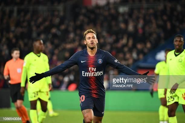 Paris SaintGermain's Brazilian forward Neymar celebrates after scoring a goal during the French L1 football match between Paris SaintGermain and...