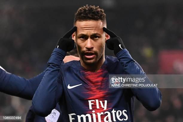 Paris SaintGermain's Brazilian forward Neymar celebrates after scoring a goal during the French L1 football match Paris SaintGermain vs Guingamp on...