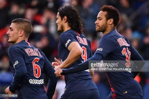 Paris SaintGermain's Brazilian forward Neymar celebrates after scoring a goal with Paris SaintGermain's Italian midfielder Marco Verratti and Paris...