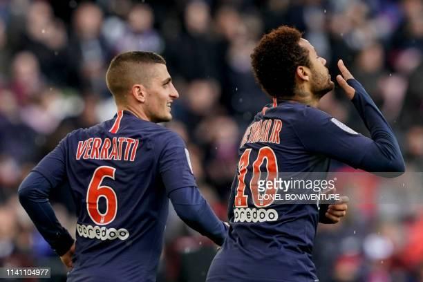 Paris SaintGermain's Brazilian forward Neymar celebrates after scoring a goal with Paris SaintGermain's Italian midfielder Marco Verratti during the...