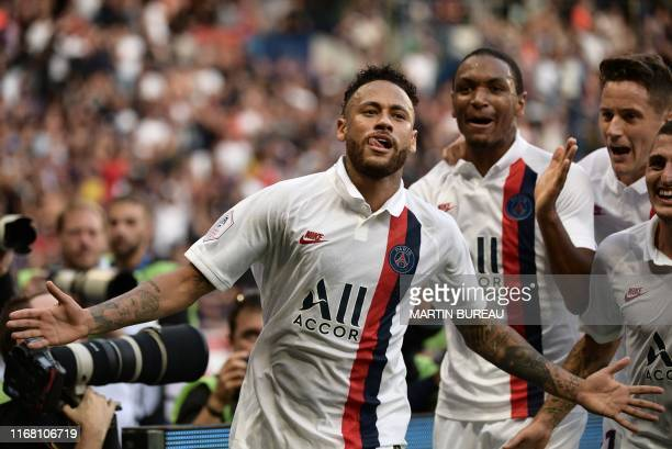 TOPSHOT Paris SaintGermain's Brazilian forward Neymar celebrates after scoring a goal during the French L1 football match between Paris SaintGermain...