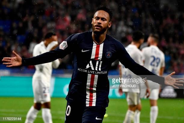 TOPSHOT Paris SaintGermain's Brazilian forward Neymar celebrates after scoring a goal during the French L1 football match between Olympique Lyonnais...