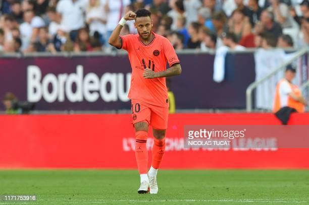 TOPSHOT Paris SaintGermain's Brazilian forward Neymar celebrates after scoring a goal during the French L1 football match between Girondins de...