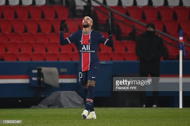 Paris Saint-Germain's Brazilian forward Neymar celebrates after scoring the opener during the UEFA Champions League group H football match between...