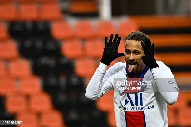 Paris Saint-Germain's Brazilian forward Neymar celebrates after scoring a goal during the French L1 football match between FC Lorient and Paris...