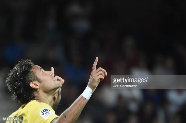 Paris SaintGermain's Brazilian forward Neymar celebrates after scoring a goal during the French L1 football match Paris SaintGermain vs En Avant...