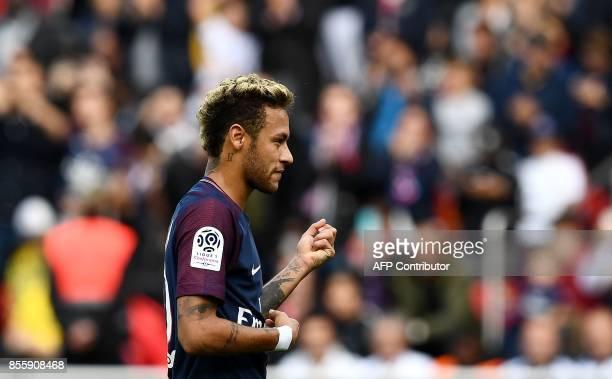 Paris SaintGermain's Brazilian forward Neymar celebrates after scoring a penalty kick during the French L1 football match Paris SaintGermain vs...