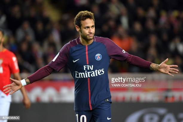 Paris SaintGermain's Brazilian forward Neymar celebrates after scoring a penalty kick during the French L1 football match between Monaco and Paris...