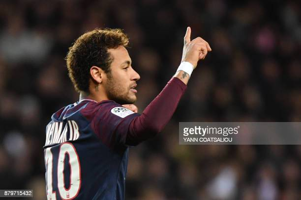 Paris SaintGermain's Brazilian forward Neymar celebrates after scoring a penalty kick during the French L1 football match between Monaco and Paris...