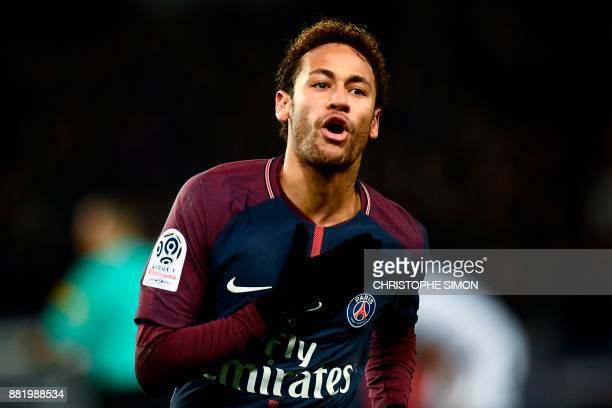 Paris SaintGermain's Brazilian forward Neymar celebrates after scoring a goal during the French L1 football match between Paris SaintGermain and...