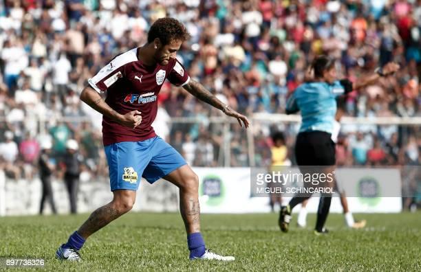 Paris SaintGermain's Brazilian forward Neymar celebrates after scoring during the charity football match 'Ball Hunger Only' at the Jaime Cintra...