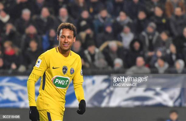 Paris SaintGermain's Brazilian forward Neymar celebrates after scoring during the French cup football match Rennes vs Paris SG at the Roazhon Park in...