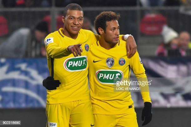 Paris SaintGermain's Brazilian forward Neymar celebrates after scoring with Paris SaintGermain's French forward Kylian Mbappe during the French cup...