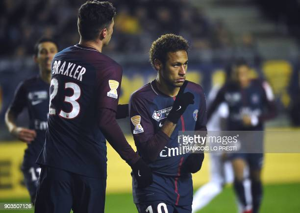 Paris SaintGermain's Brazilian forward Neymar celebrates after scoring a penalty kick during the French League Cup quarterfinal football match...