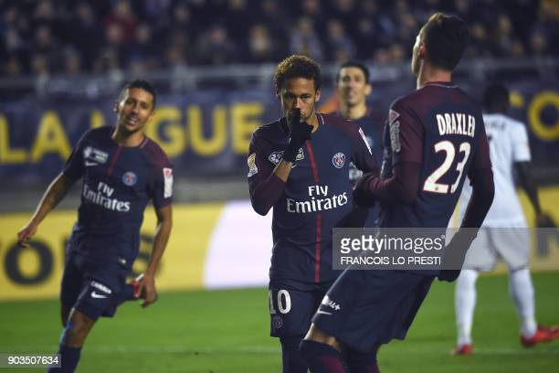 Paris SaintGermain's Brazilian forward Neymar celebrates after scoring a penalty kick during the French League Cup quarterfinal football match...