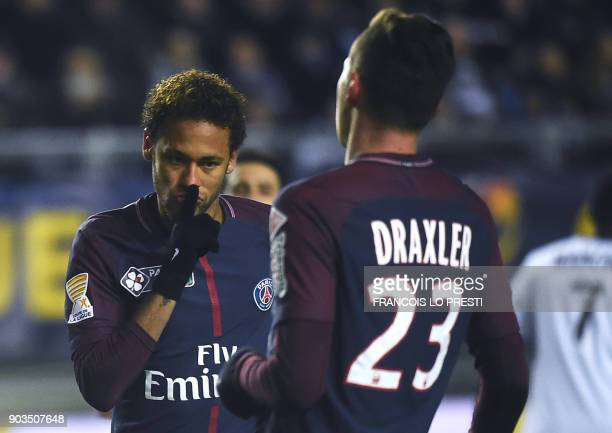 TOPSHOT Paris SaintGermain's Brazilian forward Neymar celebrates after scoring a penalty kick during the French League Cup quarterfinal football...
