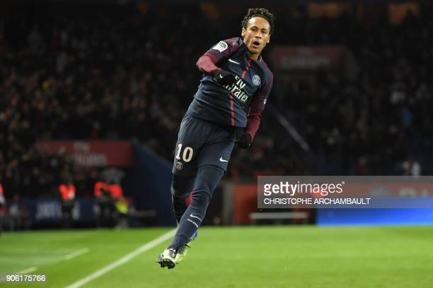 TOPSHOT Paris SaintGermain's Brazilian forward Neymar celebrates after scoring his tyeam's sixth goal his third own during the French L1 football...