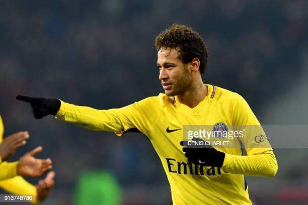 Paris SaintGermain's Brazilian forward Neymar celebrates after scoring a goal during French L1 football match between Lille Losc and Paris...