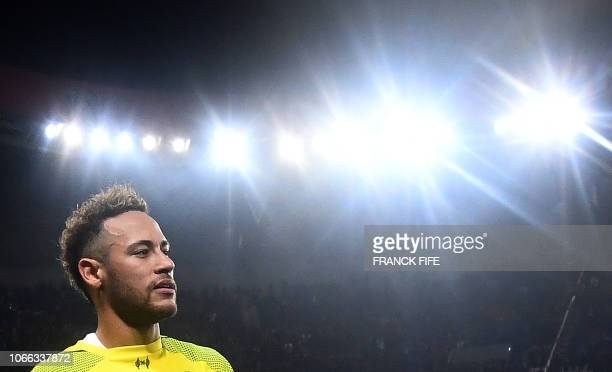 TOPSHOT Paris SaintGermain's Brazilian forward Neymar celebrates after the team's 21 win of the UEFA Champions League Group C football match between...