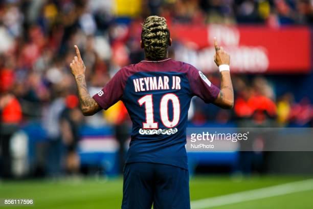 Paris SaintGermain's Brazilian forward Neymar celebrates during the French L1 football match between Paris SaintGermain and Bordeaux at the Parc des...