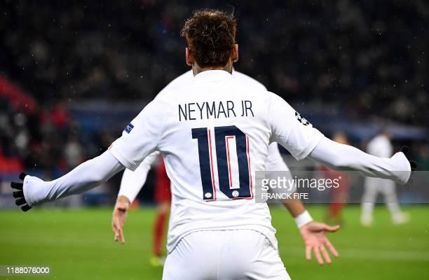 Paris Saint-Germain's Brazilian forward Neymar celebrates his goal during the UEFA Champions League Group A football match between Paris...