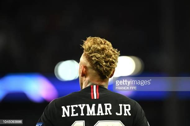 Paris SaintGermain's Brazilian forward Neymar celebrates his second goal during their UEFA Champions' League football match Paris Saint Germain...