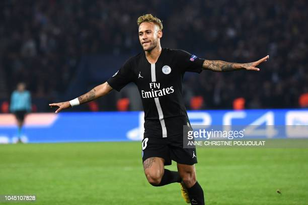 Paris Saint-Germain's Brazilian forward Neymar celebrates his third goal during their UEFA Champions' League football match Paris Saint Germain...