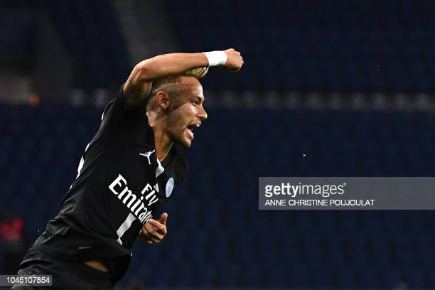 TOPSHOT Paris SaintGermain's Brazilian forward Neymar celebrates his third goal during their UEFA Champions' League football match Paris Saint...