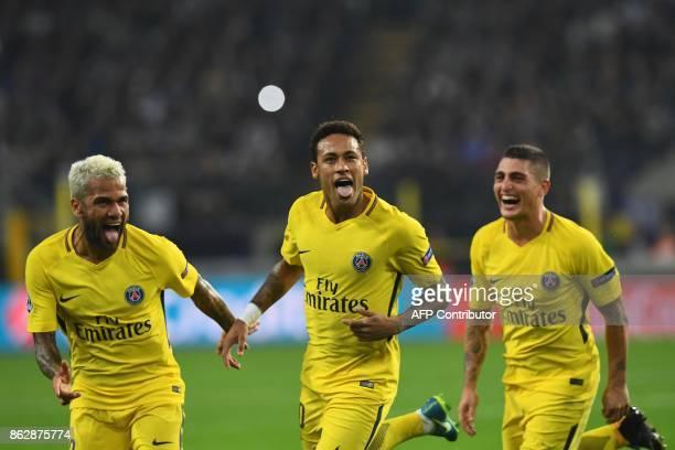 Paris SaintGermain's Brazilian forward Neymar celebrates scoring a goal with Paris SaintGermain's Brazilian defender Dani Alves and Paris...