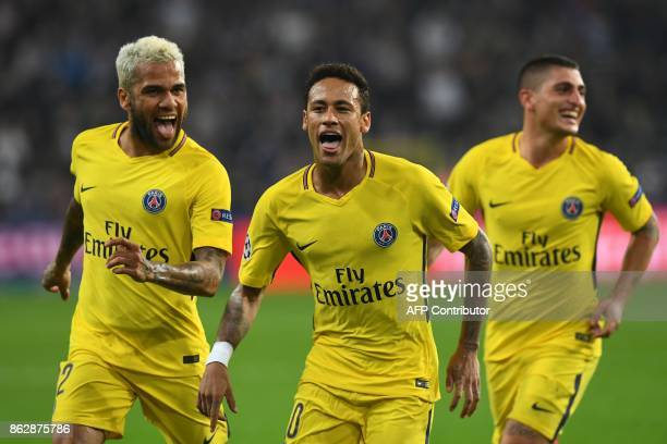 Paris SaintGermain's Brazilian forward Neymar celebrates scoring a goal with Paris SaintGermain's Brazilian defender Dani Alves and Paris...