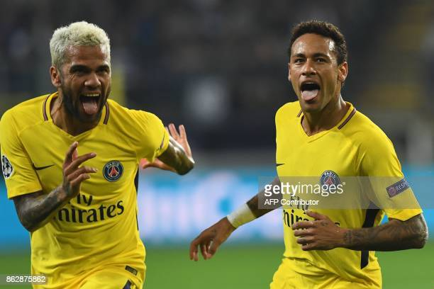 Paris SaintGermain's Brazilian forward Neymar celebrates scoring a goal with Paris SaintGermain's Brazilian defender Dani Alves during the UEFA...