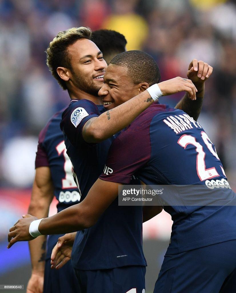 Paris Saint-Germain's Brazilian forward Neymar (L) celebrates scoring the opening goal with Paris Saint-Germain's French forward Kylian Mbappe during the French L1 football match Paris Saint-Germain (PSG) vs Bordeaux (FCGB) on September 30, 2017 at the Parc des Princes stadium in Paris. /