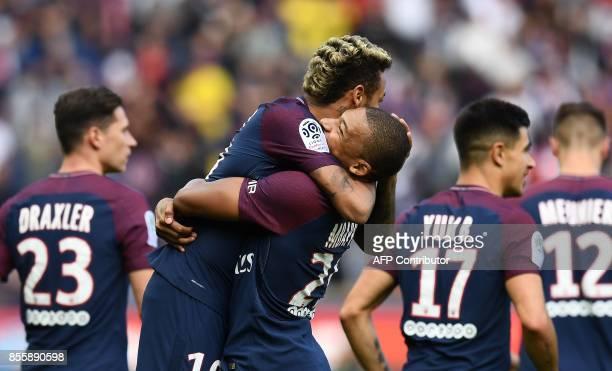 Paris SaintGermain's Brazilian forward Neymar celebrates scoring the opening goal with Paris SaintGermain's French forward Kylian Mbappe during the...