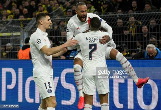 Paris Saint-Germain's Brazilian forward Neymar celebrates scoring with his team-mates Paris Saint-Germain's French forward Kylian Mbappe and Paris...