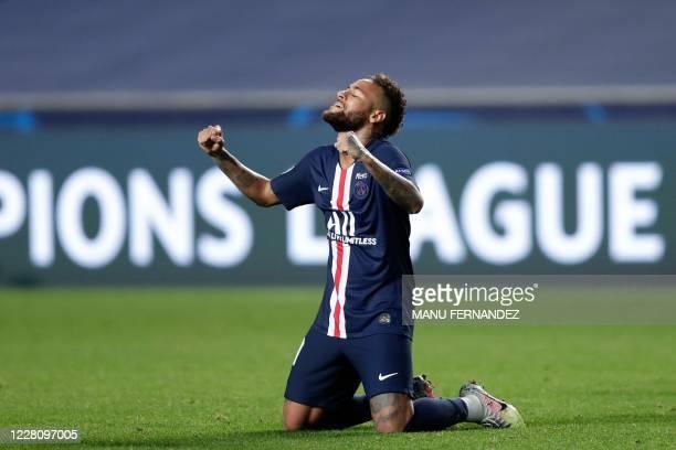 Paris Saint-Germain's Brazilian forward Neymar celebrates the victory at the end of the UEFA Champions League semi-final football match between...